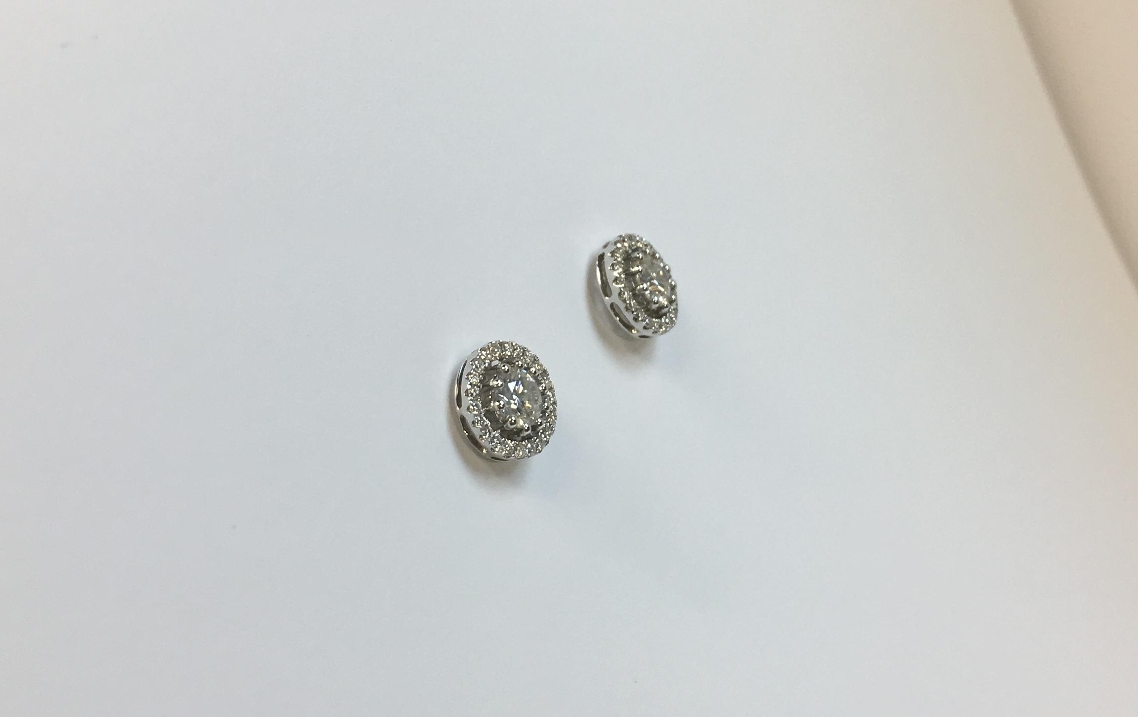 Extravagant 18K White Gold Diamond Earrings