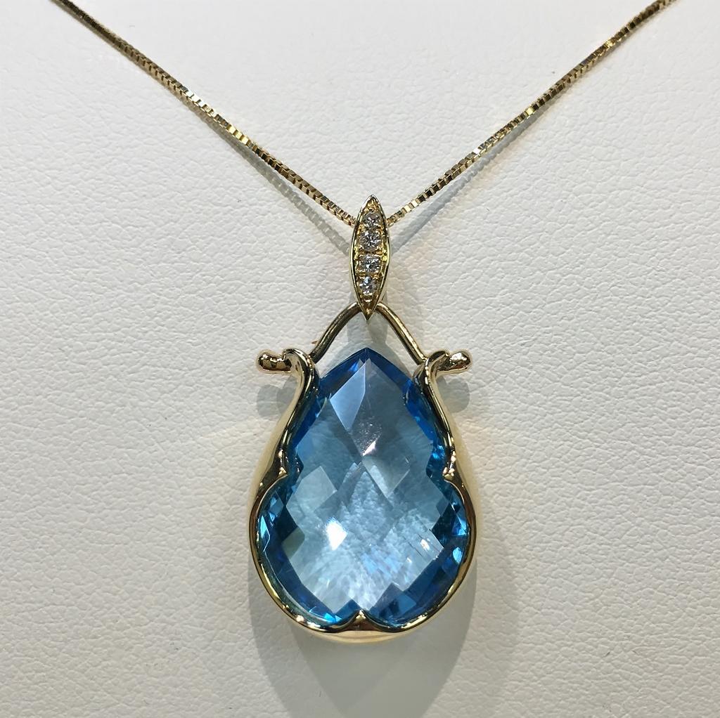 14K Yellow Gold 11 Carats Blue Topaz & Diamond Pendant