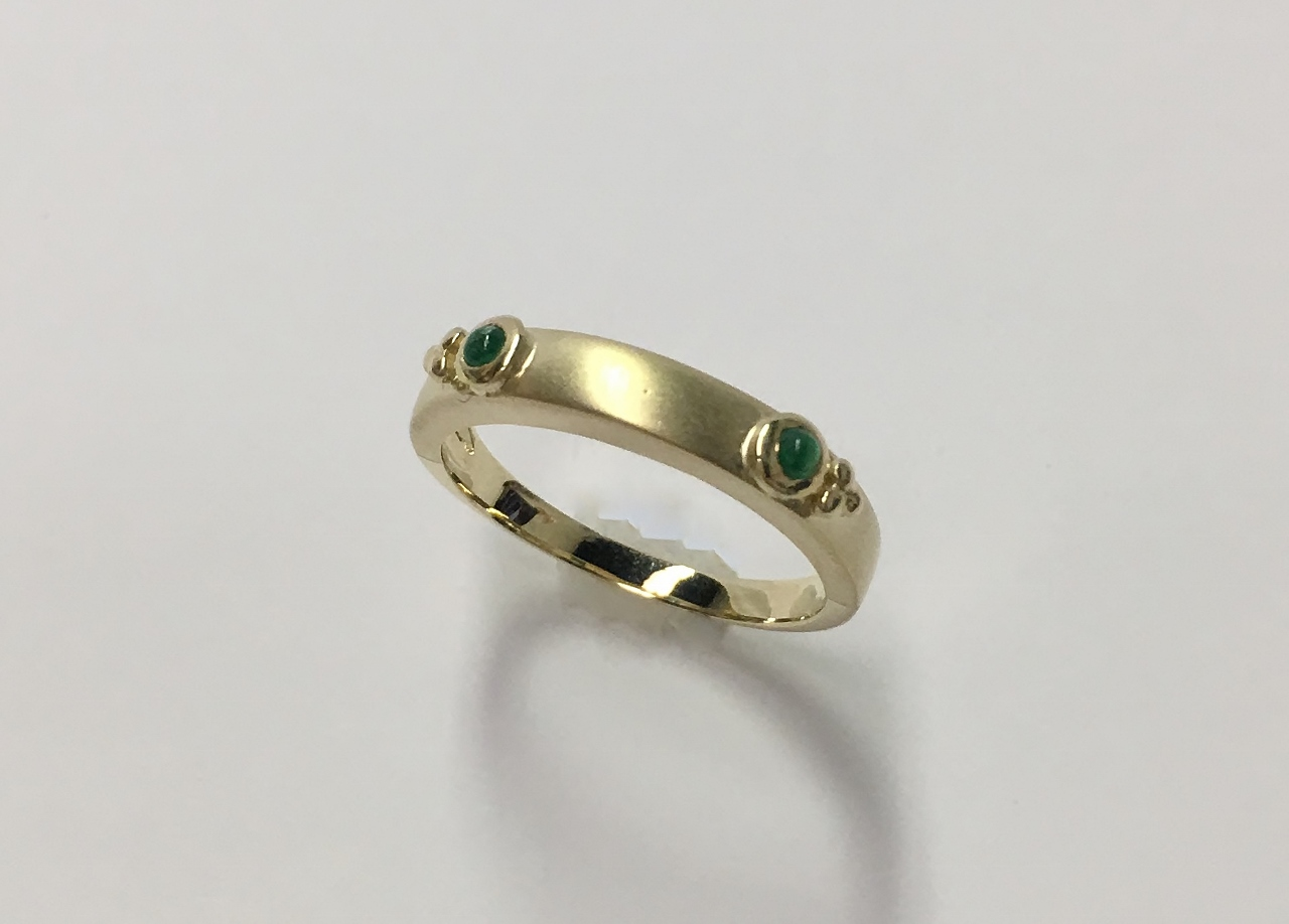 An Estate 14K Yellow Gold Band With Emeralds