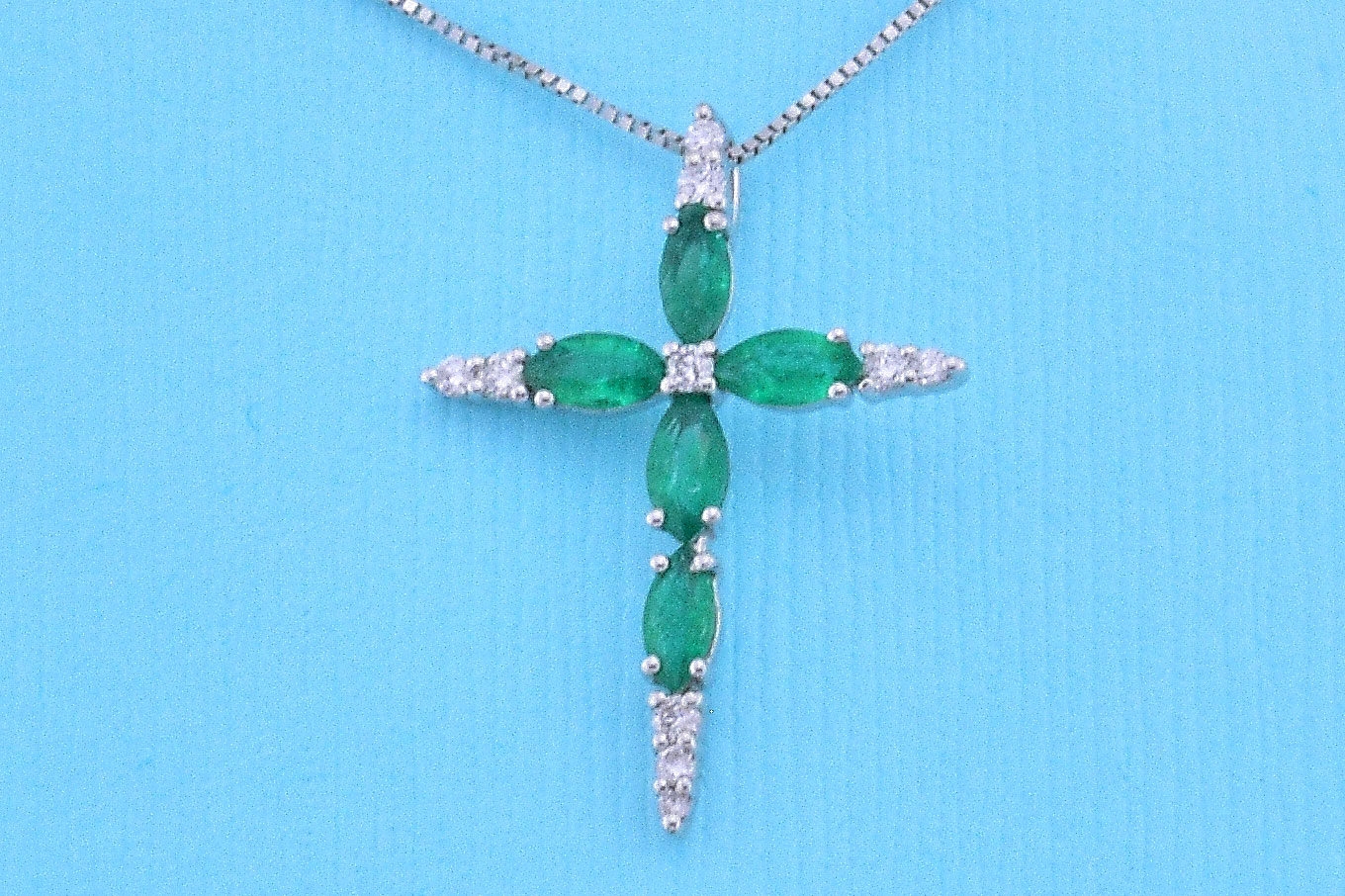 Emerald Cross Pendant In White Gold