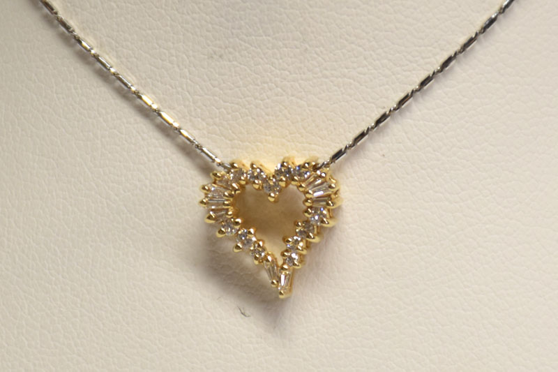 A Quarter Carat Yellow Gold Diamond Pendant