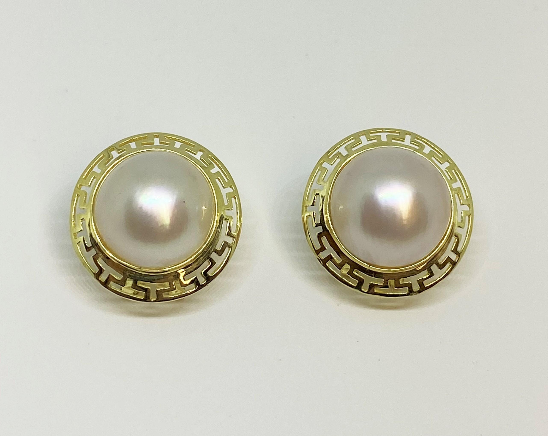 13.0 Millimeters Mother Of Pearl Earrings